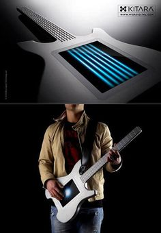 """Misa Digital's Kitara was basically the first digital musical instrument to make use of a touch-button strings/frets, along with an 8"""" multi-touch display.    Isn't it so cooool..??"""