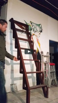 Folding up and down of the Bcompact stairs, Hardwood ladder version.