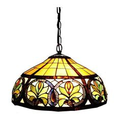 Warm up the lighting in your kitchen or family room with this handcrafted stained glass hanging lamp. Constructed with hand-cut pieces of stained glass and bronze finished details, this lamp creates an eye-catching display of light and color.