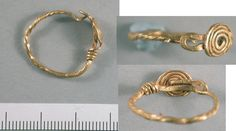 'Roman filigree gold ring. The hoop consists of a drawn strand of wire which has been twisted along its length, with a simple hook-and-loop catch formed by the wire terminals. The top of the ring is decorated with a thinner piece of wire formed into an applied quadruple spiral, the end of which has been twisted around one of the shoulders.  Date: c. 1st to 2nd centuries AD  Failsworth East, Oldham  Ext. d.: 19.0mm Int. d.: 16.0 mm Wt.: 1.91g.