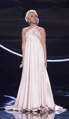 Undercover: Lady Gaga, 30, hid her bodyart underneath an elegant Brandon Maxwell halter-neck dress with silky pleats for her appearance at the Royal Variety Performance inside the Hammersmith Apollo on Tuesday night