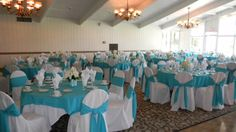 Tiffany blue turquoise wedding guests tables and chairs hall setup.