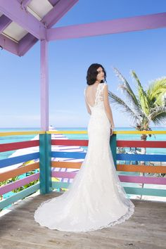 """Spring 2014  Style #3785  """"Luscious Long Island - Two piece slim lace and tulle overlay and charmeuse slip gown. Overlay features square neckline, cap sleeves and deep V-back. Gown is finished with chapel length train and charmeuse buttons enclose the back."""""""