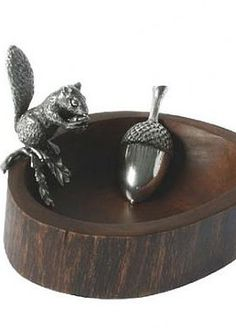 As beautiful as it is functional, the Pewter Squirrel Nut Bowl and Scoop is a fabulous conversation piece that welcomes guests in for a snack at your parties.