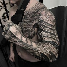 sleeve tattoo themes for men   Photo by (the.inked.society) on Instagram