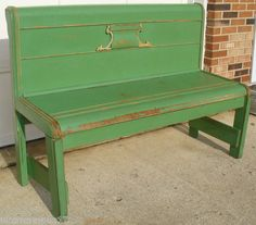 This is a large vintage handmade green wooden bench made from an antique Headboard and Footboard bed.