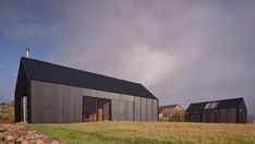 """Mary Arnold-Forster Architects designed the tin-clad Black Shed house on the Isle of Skye for an architect and a rabbi with an """"interest in melancholy. Black Shed, Black Barn, Black House, 17 Black, Farm Shed, Open Architecture, British Architecture, Modern Barn House, Agricultural Buildings"""