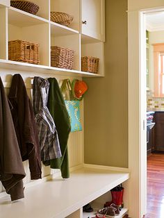 Use Overhead Space. Having this as a part of the front entry way allows for quick entry and exit while maintaining the balance in the house by keeping things organized. I would put each family members name on the basket so they can each take it to their room to empty out.