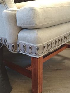design indulgence: Chair upholstered in simple linen flax with this pretty Fabricut trim to give it some interest.