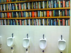 This one just made me laugh. Fake bookshelf in toilets by lloydi, via Flickr