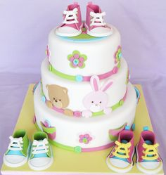 Baby shoes cake - I made this cake for Squires Kitchen's Cakes and Sugarcraft magazine issue 112.
