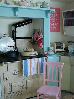 Fun retro colour scheme lifts this cottage kitchen. Aga Kitchen, Cosy Kitchen, Kitchen Decor, Cottage Kitchens, Home Kitchens, Country Kitchens, English Kitchens, La Cornue, Old Stove