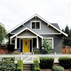 That yellow door tho. Craftsman Bungalow Exterior, Cottage Exterior, House Paint Exterior, Craftsman Bungalows, Exterior House Colors, Home Town Hgtv, Yellow Front Doors, Suburban House, Grey Houses