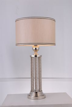 """Modrest Geddes Modern Nickel Table Lamp VGKRBT-1013 $241  Product: 70454  Features:  Black Nickel Finished Steel Base Beige Lamp Shade 1 Bulb Bulb Type: E26 Max 60W Dimensions:   Table Lamp: W15"""" x D15"""" x H28"""""""