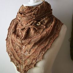 The Joyeux Shawlette knitting pattern - fun and fairly quick knit - perfect for a marathon movie afternoon (or two), by Phydeaux Designs.  :)