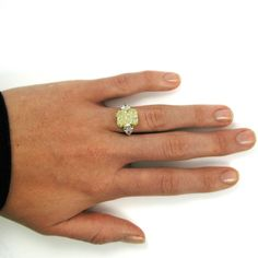 7.17 Carat Fancy Yellow Radiant Cut Diamond Ring GIA | From a unique collection of vintage engagement rings at https://www.1stdibs.com/jewelry/rings/engagement-rings/