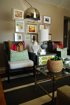 Paint the drawers of a side table and coordinate your throw pillows. Ensure the matting or colors in your pictures tie in....or go black/white or sepia.  In this case, black and white to match the rug.