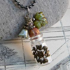 Fairy Tale Bottle Necklace - SIMPLY CINDERELLA  - Tiny Bottle with Pumpkin and Glass Slipper Shards. $30.00, via Etsy.