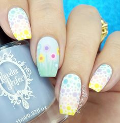 These cute little polka dots are easier if you use the colors you want as the base. Then you can use a polka dot stencil and then paint the white nail polish. The accent of the design is the cute litte flowers in different colors.