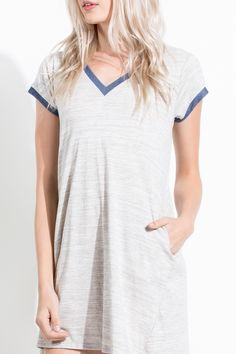 Love this t-shirt dress with the blue contrast! This dress even has pockets for the most comfortable and cute everyday outfit.