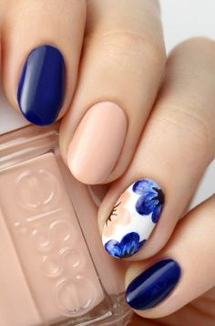 """Neutral Floral: If you want to embrace spring"""" but don't love sugary pastels opt for a navy and nude manicure with a floral accent nail. It's bold, soft and, best of all, seasonal. Click through for more Easter nails."""