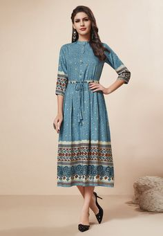 Blue rayon foil stylish kurti online shopping at best discount prices. Blue color fancy kurti is rayon foil fabric with print work and foil print work. Blue color printed kurti large collection available. Simple Kurti Designs, Kurta Designs Women, Salwar Designs, Modest Fashion, Fashion Dresses, Western Dresses Online, Girls Frock Design, Fancy Kurti, Short Frocks
