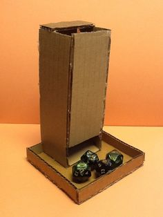 Hello Everyone, In this tutorial, I will show you how to make a card board dice tower. For those of you who don't know, a dice tower is a small tower that you can. Tabletop Rpg, Tabletop Games, Board Game Geek, Board Games, Game Boards, Dice Tower, Blood Bowl, Diy Cardboard, Cardboard Organizer