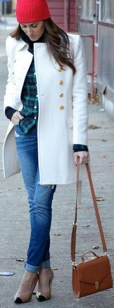 red beanie white coat tartan shirt jeans and heels.