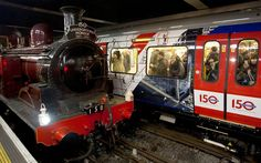A newly restored steam engine built in 1898, known as Met Locomotive No 1, arrives at Moorgate station in a recreation of the first London Underground journey