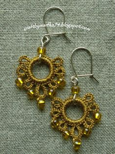 dangly crocheted hoops with bead accents on fish hook style earrings