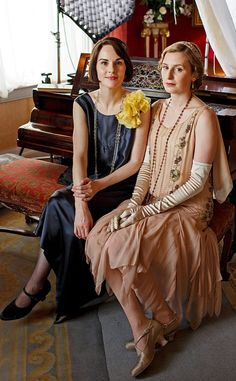 Lady Mary and Lady Edith in their evening gowns on Downton Abbey.