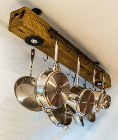 Vintage reclaimed wood kitchen rack/ pot hanger, brought into modern look and styling. $140.00 USD Materials: reclaimed wood, recycled wood, Motion lighting, LED Lighting, Beeswax, teak oil, reclaimed metal, gas pipe, wire hanger, chain hanger, vintage wood, custom lighting, natural finish. Ships worldwide from Washington, D.C.