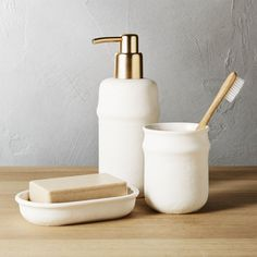 Shop canvas bath accessories.   Crisp white ceramic stands out from the ordinary with a unique two-textured surface.  Base resembles a nubby fabric stopping just short of the ribbed edge for a smooth finish.