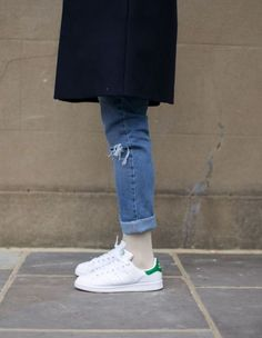 Roll up your denim cuffs to show off those Adidas Stan Smiths