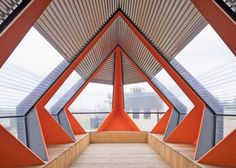 A huge ribcage-like structure cradles the angular corrugated steel and plastic body of this pavilion designed by Dutch architect Frank Havermans to host a series of summer events.