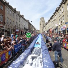 Luke Jerram transforms Bristols Park Street into 90-metre water slide.