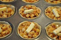 Cut 8c apples into bits.Mix apples with:12 TBS flour,1 1/2c  sugar,4 tsp cinnamon.1/4-1/2 tsp nutmeg.cut  4 TBSP chilled butter into 24 equal portions.   2 boxes pilsbury pie crusts.Unroll 1st pie crust & cut several circles out. Use a wide mouth mason jar ring.Line each muffin cup with a tiny pie crust.Fill the crusts with your apple mixture.Fill til slightly mounded and put dab of butter on each.Cover as desired w/left over dough.Brush with melted butter.bake at 400 for 18-22 min.yield 24…