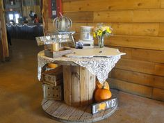 "Guest book table from our rustic barn fall wedding. Loved the look of the big wooden spool and the height was perfect for people to sign our wooden ""guest book"" of Texas. Wedding Shower Decorations, Fall Wedding Centerpieces, Centrepieces, Guest Book Table, Guest Books, Wedding Photo Booth Props, Wedding Guest Book, Fall Decor, Wedding Ideas"