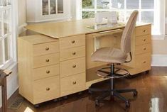 elevated sewing cabinet/cutting table - love the higher chair and the raised foot bed for the pedal