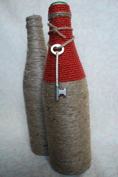 Red & brown twine wrapped glass bottle. Perfect for home accents or rustic wedding centerpieces. Add flowers or leave as is for a lovely rustic accent!