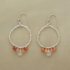 Sunstones signify daybreak between white and peach moonstones. Sterling silver