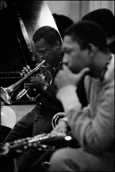 1958. John Coltrane and Miles Davis during a recording session at Columbia Records.