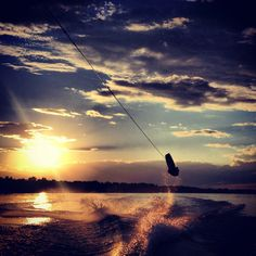 Wakeboarding at sunset. Can't wait to get Riley out there again!