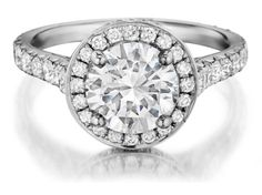 Check out this jaw-dropping HENRI DAUSSI round diamonds engagement ring, available in your choice of metals!!