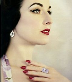 Dita Von Teese giving us total 1940's movie star glamour face and 2012 nail shape. FIERCE