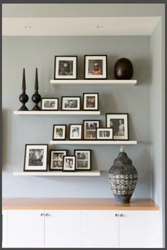 Ikea floating shelves and some frames with some great photos and ta-da.....nice!