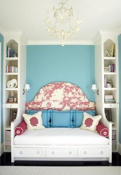 Handy bookshelves on either side. Could even extend the bed to a twin for a young girls room.