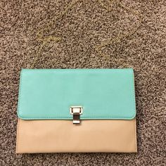 Mint and tan purse This purse has a detachable gold chain allowing it to worn as a clutch. Never used! Has multiple pockets for all your necessities Perfect accessory to add to any spring/summer outfit.  Bags Mini Bags