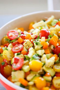 Summer Corn Avocado Basil Salad is a healthy salad perfect for the hot summer months that is filled with fresh corn, ripe avocados, sweet basil, cherry tomatoes, peppers and zucchini.