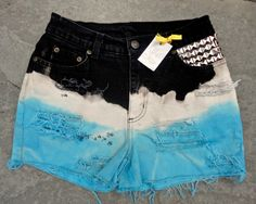 Upcycled jeans shorts by 16-year old designer Sophia Scanlan for Stubborn Jeans. High-waisted, black/white/turquoise with studs.